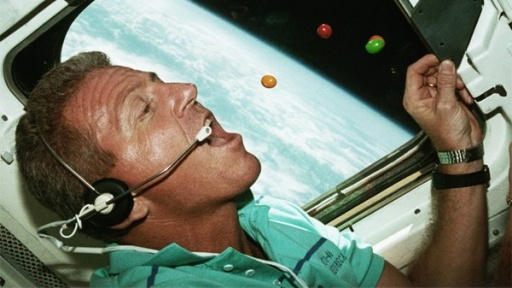 Astronaut enjoying a zero-gravity meal