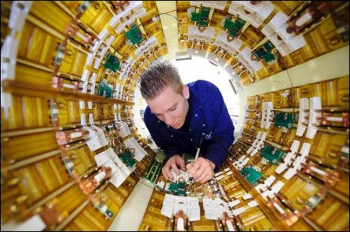 Engineer working on MRI scanner